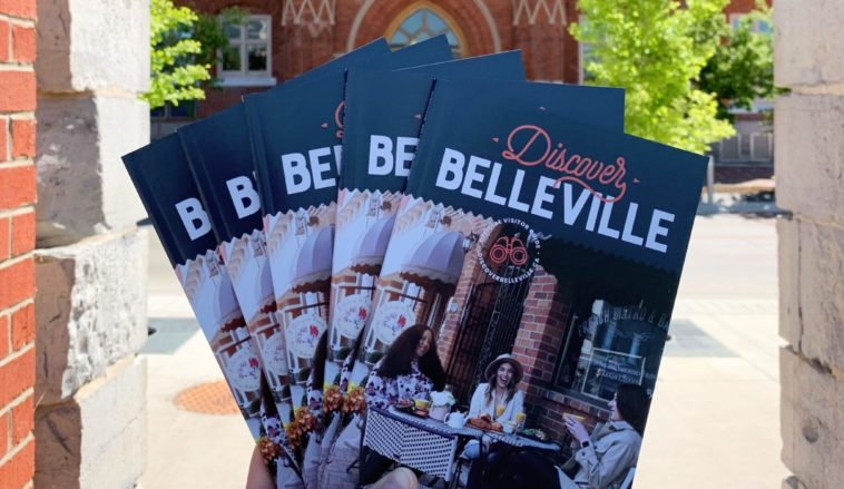 Photo of Discover Belleville guides held up in front of City Hall.
